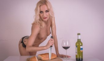 Girl with knife and bread and wine