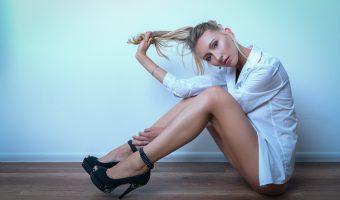 Girl in high heels pulling her hair