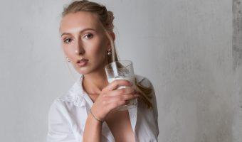 Beautiful female model drinking a glass of milk