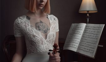 Photograph of a female model in lingerie holding a violin