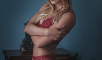French female model wearing red lingerie