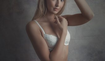 Photograph of a female model in white lingerie